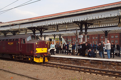 A gallery of wellwishers gather on the platform as Ray Towell poses with his headboard. 05/05/11.