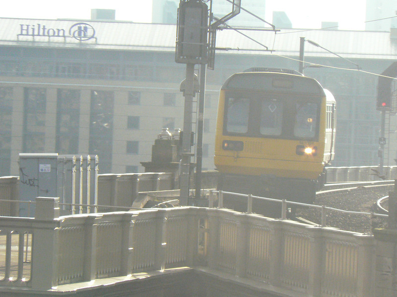 Class 142 railbus 142026 is seen on the High Level Bridge at Newcastle. 10th February 2011.