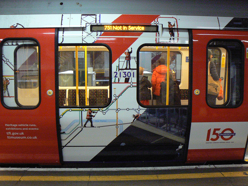 The detail on the side of 21301, showing TfL's 'men at work' images on the underground map. Sunday 13th January 2013.