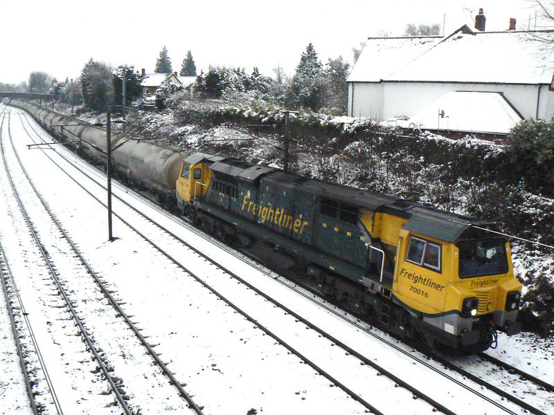 70016 heads South through a snowy St Albans with 6L45 Earles Sidings (Hope) to West Thurrock loaded cement tanks. Monday 11th February 2013.