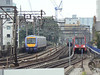 A busy scene at Shadwell as C2C 357025 heads out of London passing DLR units 110 and 40. Fri 20th August 2010.