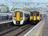 379011 alongside 317664 at Bethnal Green. Wed 11th May 2011.