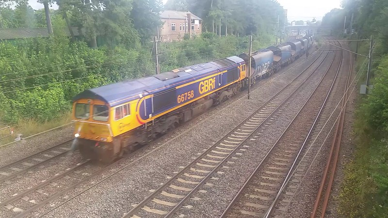 66758 heads North through St Albans on 6Z54 Colnbrook - Bardon Hill empty stone hoppers. Monday 27th July 2015.