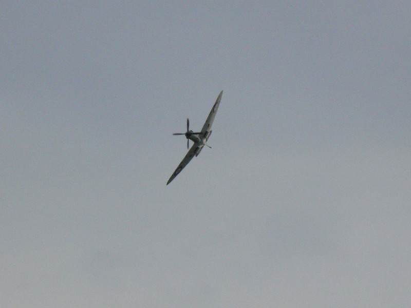 A banking spitfire passes over the Fawley Hill Steam and Vintage weekend event. 19th May 2013.