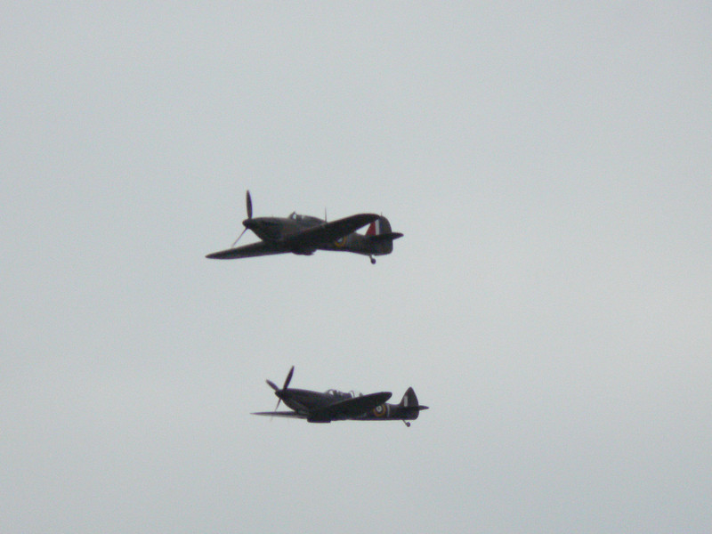 Two spitfires pass over the Fawley Hill Steam and Vintage weekend event. 19th May 2013.