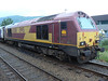 67030 with Scottish flags at Fort William waiting with the Caledonian sleeper coaches. 15/07/11