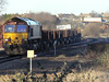 66194 passes Swinton with empty steel coil wagons from Lackenby - Margam? Saturday 30th January 2010.