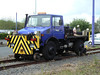 Birmingham Metro road-rail Unimog Q179 VOH (works number 166200) at Wednesbury Depot. 12th May 2012.