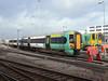377472 is seen in the sidings at Brighton Lovers Walk depot alongside 313204. 29th December 2011