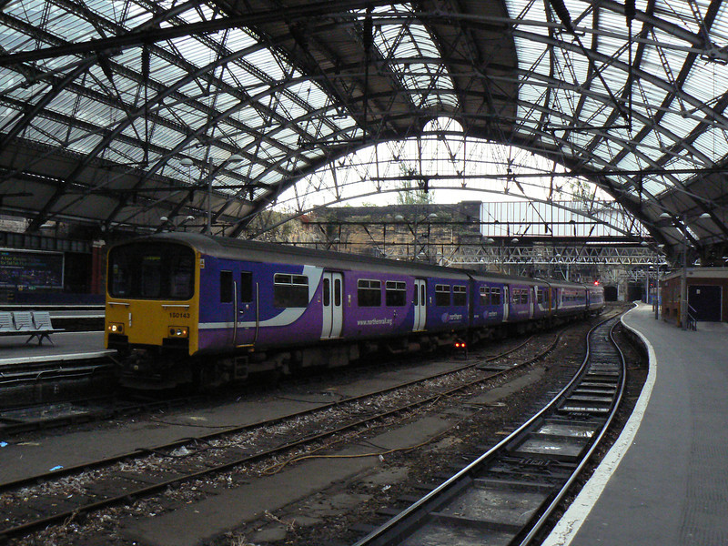 150143 and 156460 arrive at Liverpool Lime Street. Saturday 20th October 2012.