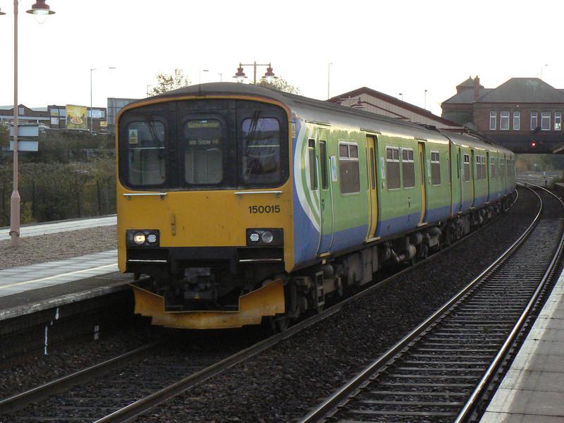 In it's last weeks working for London Midland, 150015 passes Tyseley on the TS334 diagram, working 09:09 Dorrindge to Kidderminster. Saturday 29th October 2011