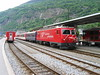 "4 June 2004 :: MGB HGe4/4 no. 105 ""Oberalp / Alpsu"" calls at Brig with a Glacier Express for Zermatt.  Of note is the old style  'Gormino' kitchen coach used on the Glacier Express at that time"