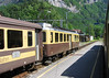 5 June 2004 ::  In the old chocolate & cream livery, Berner Oberland Bahnen (BOB) ABeh4/4 no. 304 waits at Wilderswil while working  an afternoon train from Lauterbrunnen to Interlaken Ost