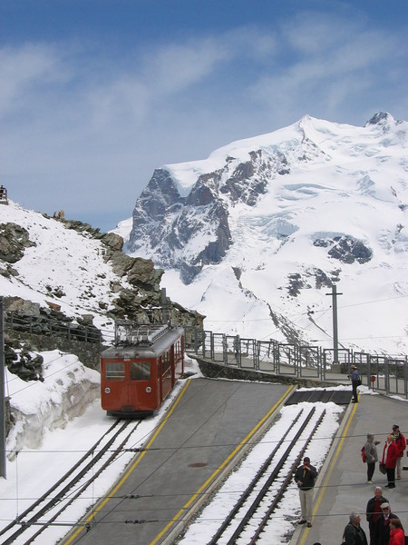 4 June 2004 :: Gornergratbahn Bhe2/4 no. 3011 is seen at Gornergrat Station.  This metre gauge rack railway links Zermatt to Gornergrat ascending to an altitude of 10,132 feet above sea level where the lack of oxygen in the air is very noticable