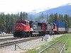 29 May 2005 :: Canadian National SD70 no. 5712 + Dash 9 2586 approach Jasper with an east bound double stack intermodal train