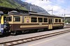 "9 May 2005 :: Old liveried BOB ABeh 4/4 no. 311 ""Grindlewald"" provides the power at the rear of the train to Lauterbrunnen and Grindlewald"