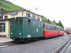 "25 June 2005 :: The Schynige Platte Bahn is an 800 mm rack railway that rises from its base station at Wilderswil.  Green He 2/2 no. 63 ""Silberdister"" is pictured with its train at Schynige Platte.  There is a very interesting alpine garden at Schynige Platte"