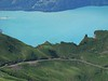 22 June 2005 :: 2 trains in the landscape taken from Rothorn summit with  a steam train on the left and a diesel on the right.  The body of water is Lake Brienz
