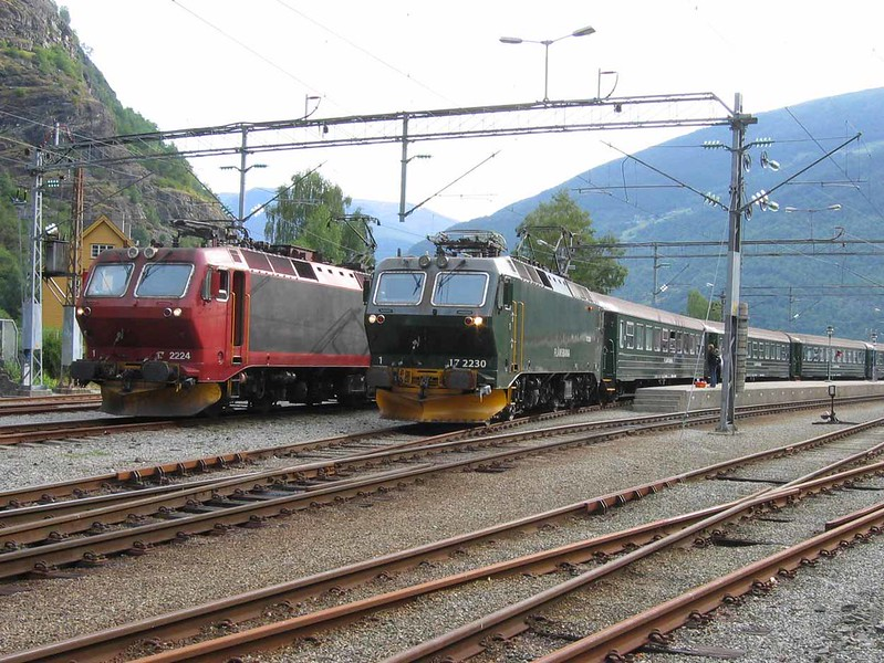 2 August 2006 :: At Flåm are 2  Flåm Railway trains with El 17 locomotives.  2224 in NSB livery and 2230 is in Flåm Railway green