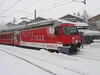 """18 January 2006 :: Another look at Glacier on Tour liveried RhB Ge 4/4iii no. 651 """"Fideris"""" at Sagliains in the falling snow"""