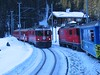 "16 January 2006 :: 2 RhB Ge 4/4 ii locomotives on passing trains on the Arosa line.  613 ""Domat / Ems"" leads a train to Chur while 618 ""Bergün / Bravuogn"" is climbing to Arosa"