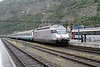 14 September 2006 :: SBB 460 107 in a special advertising livery is seen at Brig with a rake of Italian coaches and is about to work through the Simplon Tunnel to Domodossola
