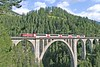 "14 September 2007 :: RhB 4/4/ no. 605 ""Silvretta"" passing over Wiesener Viadukt with a train of Glacier Express coaches"