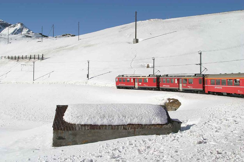 11 February 2008 :: Two RhB ABe 4/4 railcars passing a snow bound Lago Bianco on the Bernina line
