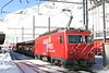 """12 February 2008 :: MGB He 4/4/ ii no. 106 """"St Gottard"""" in a Glacier Express 75 livery at Andermatt with a car carrier train from Oberwald"""
