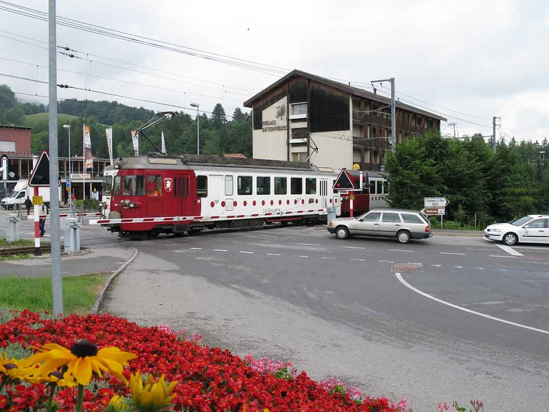 """15 July 2009 :: Gruyère–Fribourg–Morat railway (GFM) BDe 4/4 no. 141 """"Gruyère"""" passing over a level crossing at Gruyère"""