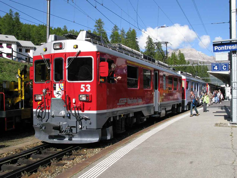 """28 September 2009 :: Being attached to a train to Tirano at Pontresina are Rhb ABe 4/4 ii no. 53 """"Tirano"""" + 51 in UNESCO livery"""