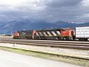 27 September 2010 :: passing slowly through Jasper is Canadian National DS75I no. 5737 + SD40 no. 5506 with a train of processed timber
