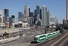 24 March 2010 :: In front of the downtown Toronto skyline a GO train heads towards Toronto Union Station