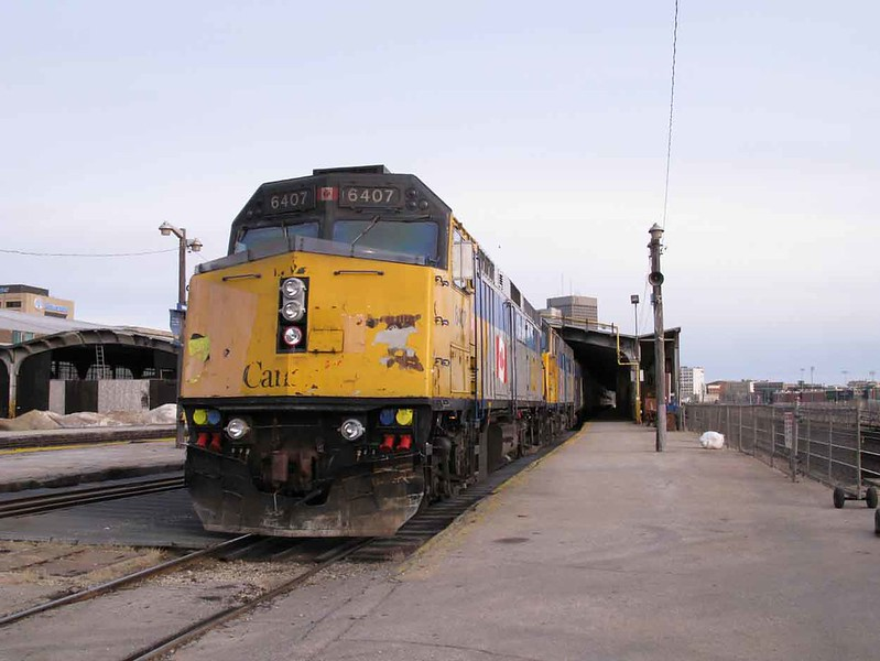 27 March 2010 :: Via Rail F40PH-2 no.s 6407 + 6449 with Train 1 is pictured at Winnipeg Station during a service stop and crew change