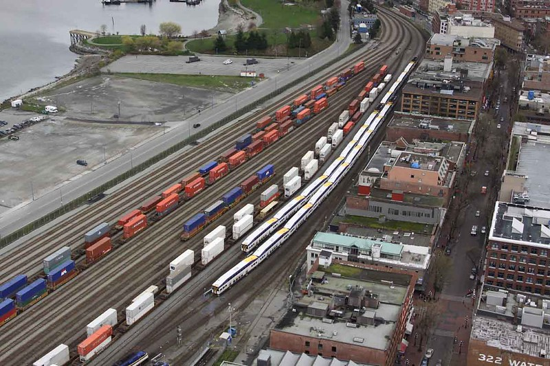 30 March 2010 :: Just outside Waterfront Station in Vancouver are 2 West Coast Express sets alongside some double stack container trains