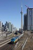 24 March 2010 :: Under the shadow of the CN Tower in Toronto, Via Rail P42DC No. 913 leads a westbound passenger train away from Toronto