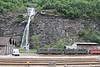 18 May 2011 :: Just outside the station at Biasca is an impressive waterfall which is behind an SBB depot where a pair of Re 6/6 locomotives are stored