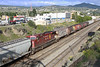 7 June 2013 :: Acting as a mid train helper in between these grain wagons is Canadian Pacific AC44CW no. 9622