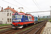 4 May 2013 :: Passing through Ruskov is Lokorail 182-072 along with 740-873 with a delivery of new box wagon flats