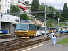 24 June 2004 :: One of the Golden Pass DVT panorama coaches is seen departing from Montreux