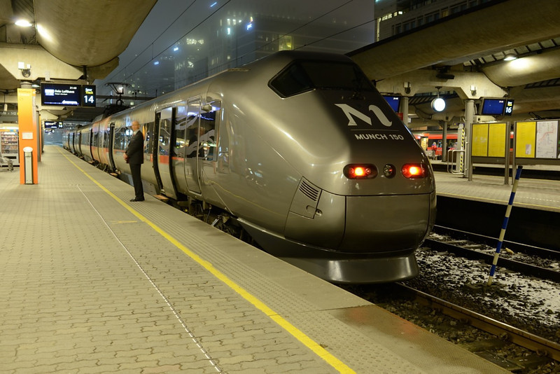21 February 2014 :: An Adtranz built Class BM71 bearing a Munch 150 logo stands at Oslo Central Station waiting to form the 2150 airport train to Oslo Lufthavn