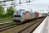 22 May 2015 :: TM Rail 193.921, a Siemens Vectron Bo-Bo heads an eastbound freight train through Hallsberg