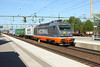 23 May 2012 :: Hector Rail intermodal freight passes through Hallsberg station with 141 002.  This locomotive was formerly operated by ÖBB
