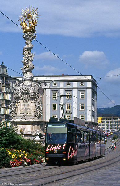 Car 51 at Hauptplatz on 12th August 1992. The 20 metre high Trinity Column, or Dreifaltigkeitssäule, was completed in 1723. The column is made of white marble from Salzburg. The column has three inscriptions which announce the dedication of the column to the Holy Trinity by the guilds, the Emperor and the people of Linz in gratitude for deliverance from the dangers of war, fire and plague.
