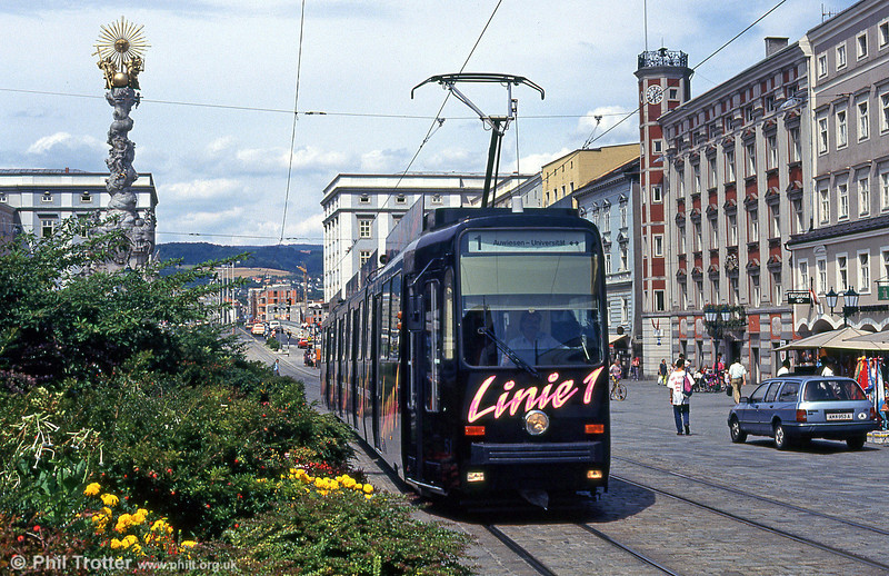 Car 51 at Hauptplatz on 12th August 1992. The building on the right with the tower is Linz's old town hall which was built in 1509 following a disastrous city fire. The building was modified by the addition of a Baroque frontage and extended in the middle of the 17th century but many features of the older building, such as the octagonal tower, survive. After the Anschluss in 1938 Adolf Hitler stayed here after being joyously received into the city. Today the building houses the offices of the mayor and the local council.
