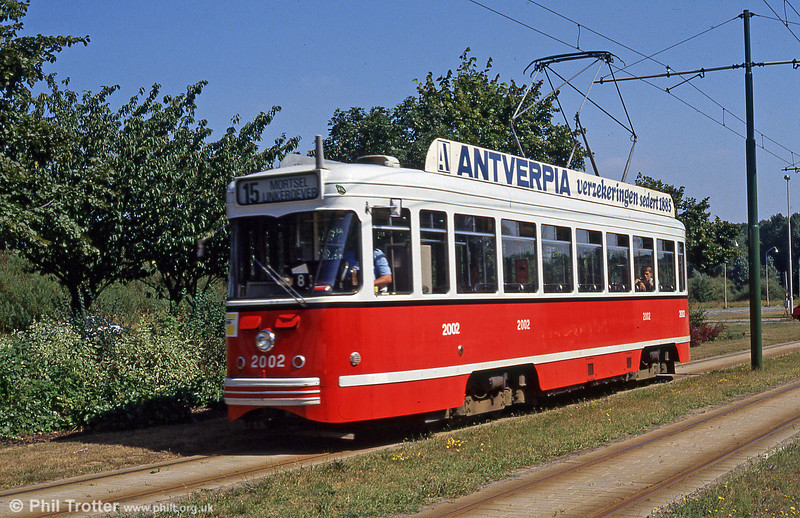 The former Antwerpen red and grey livery was particularly attractive and suited the PCC cars well. Car 2002 is seen near Sporthal on 29th August 1991.