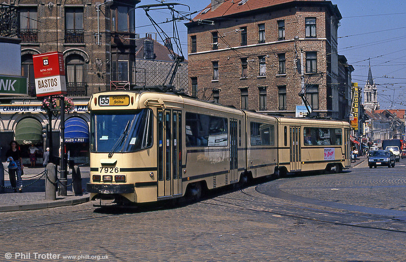 Brussels 7926 on 2nd August, 1990. The 7900 series was introduced in 1977, being of an advanced design with double articulation and tinted windows as seen here, and powered by four bogies.