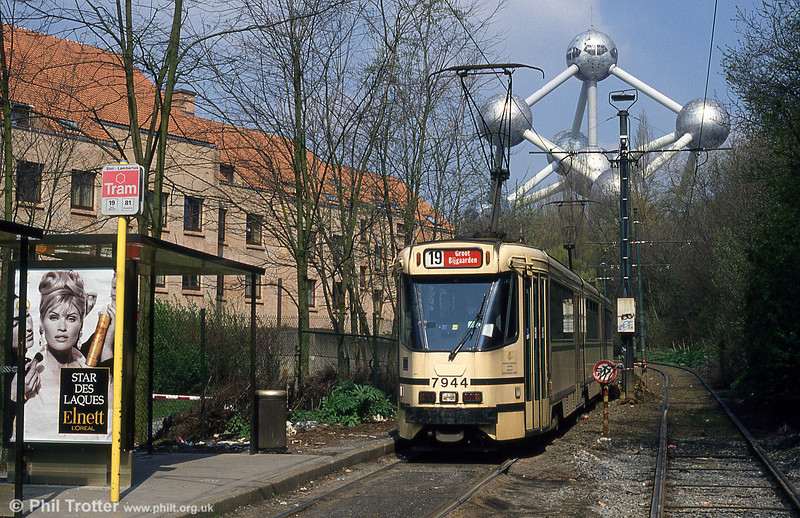 With the Atomium as a backdrop, this is Brussels 7944 slowing for the stop at St. Lambert on 12th April 1994.