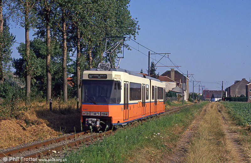 The idyllic atmosphere of a Belgian rural tramway - alas, no more. Charleroi Vicinal car 6127 near Binche on the now-closed section to La Louviere on 3rd August 1990. The section between Anderlues and La Louviere closed on 28 August 1993.