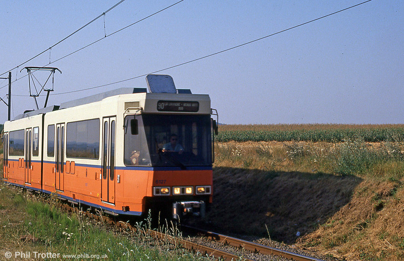 Car 6127 near Binche on the now-closed section to La Louviere on 3rd August 1990.
